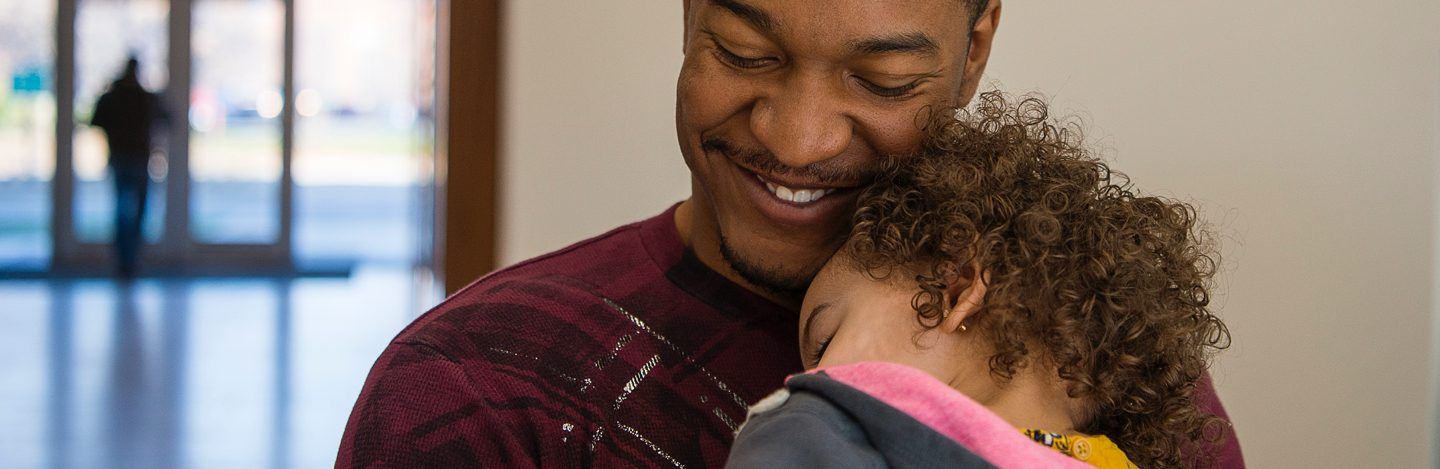 A man holding his daughter
