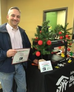 Roger Gauthier stands next to a display of his winning 3D ornament.