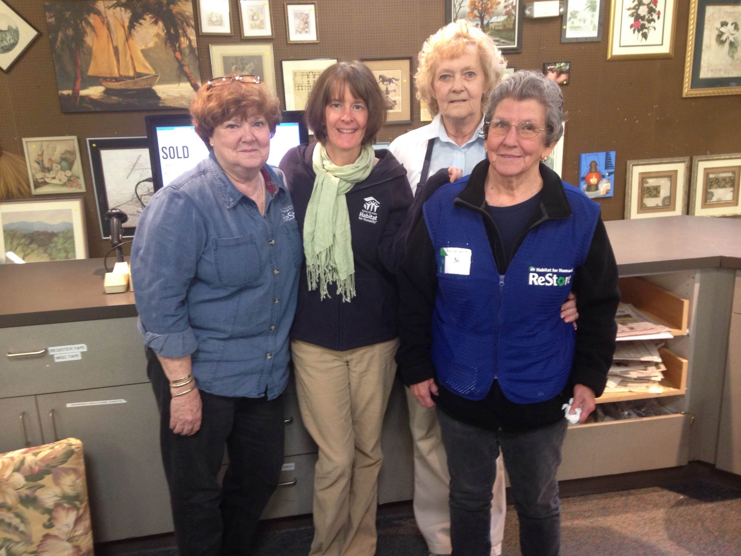 Carolyn with other ReStore volunteers and Volunteer Coordinator Carrie.