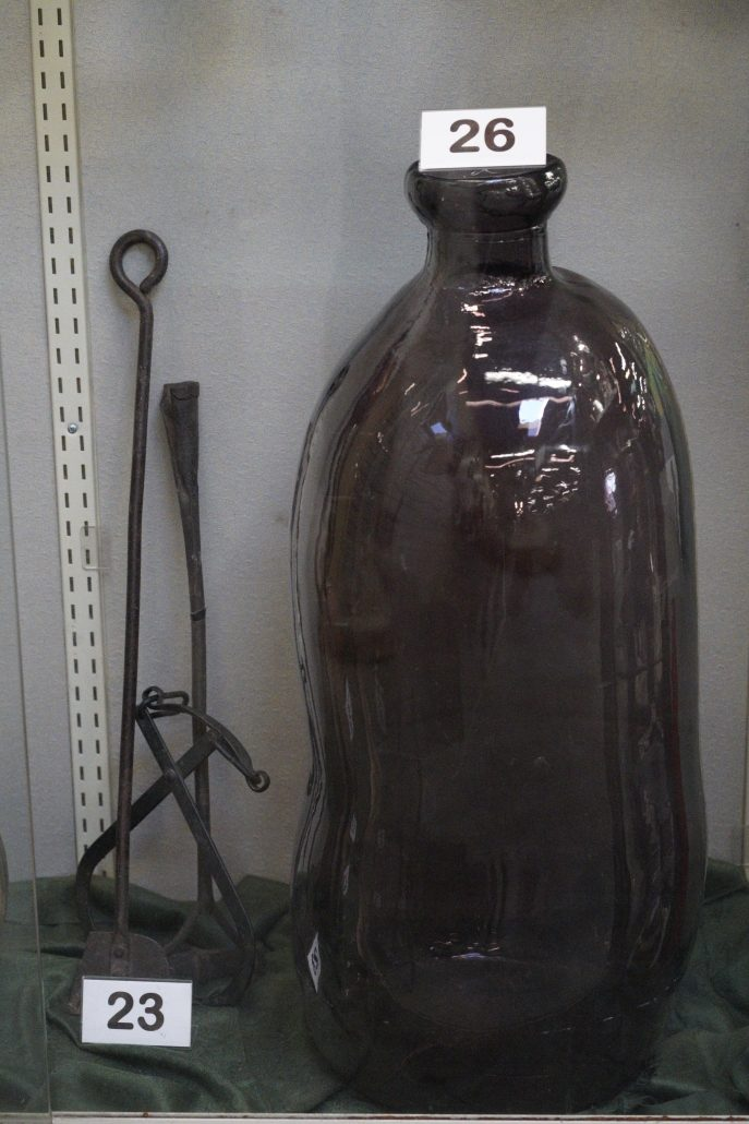 Antique farm tools and large vase