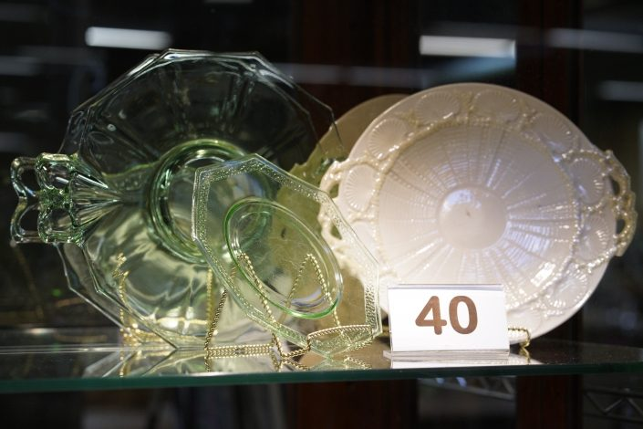 Matching green glass display dishes and white dish.