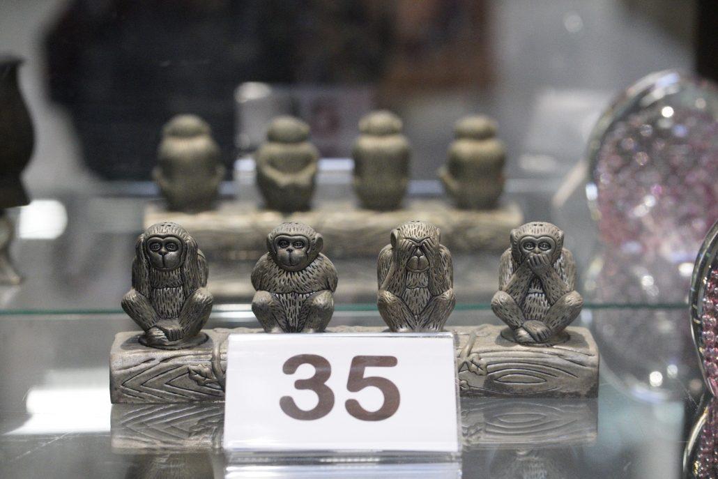 "Figurine of ""no evil"" monkeys."