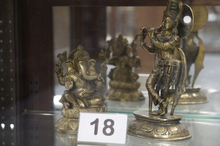 Decorative golden figurines of Hindu gods.